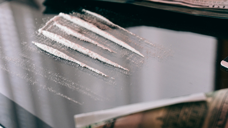 Cocaine Snorted Through Rolled 100 Dollar Banknote.  lifestyle of a drug addict