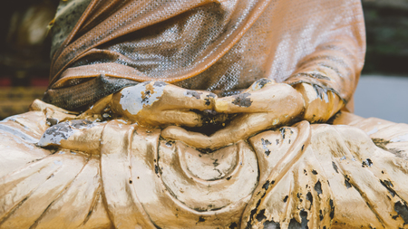 Closeup of antique wood statue of Buddha