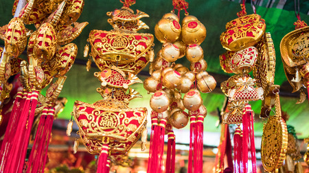 Chinese souvenir market.  Ð•raditional Chinese amulets and souvenirs in gold close-up.