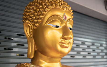 Buddha statue in Thailand and Vietnam close-up.