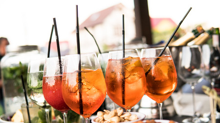 process of preparation of a cocktail Aperol spritz close-up.