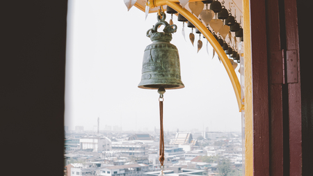 Buddhist bells in the monastery close-up. Wat Saket in Bangkok - Temple of the Golden Mount