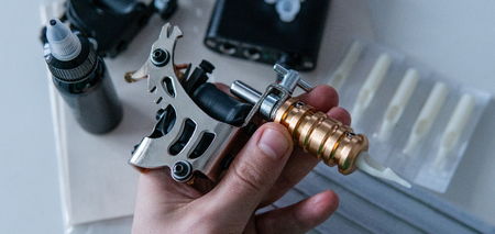 Accessories for tattooing on the skin. Tattoo machines close-up Stock fotó