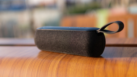 wireless speaker in use. Music lovers and modern audio technology