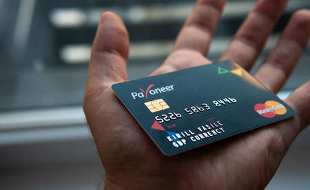 Aschheim, Germany -27 June  2020 : Blocking Payoneer cards, Wirecar company bankruptcy. Issuing Cards from Wirecard Card Solutions Editorial