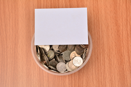 White paper mock up and stack coins in glass for save money and financial, tax season