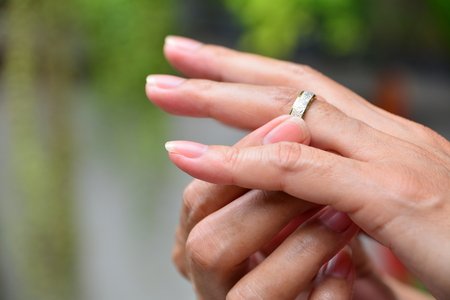 wedding rings and hands of bride and groom.