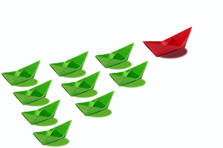 Leadership concept, red leader boat, standing out from the crowd of green boats, on white background