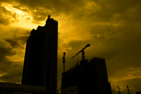 buildingsite: Silhouette construction industry building on high ground sepia style