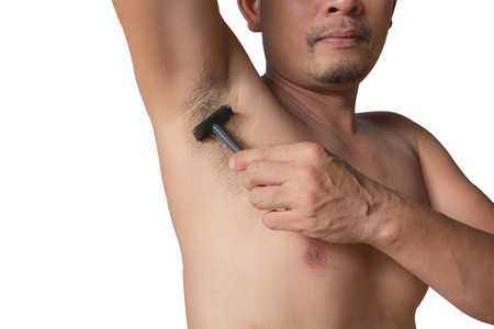 underarm: armpits and razor hairy. Shaves a mans armpit with a close-up blade isolated on a white background. Stock Photo