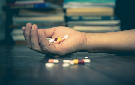 éxtasis: The man committing suicide by overdosing on medication. Close up of overdose pills and addict.