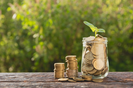 Coins in jar with money stack step growing money, Concept finance business and saving investment. Stock Photo