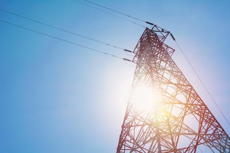 High voltage pole on blue sky background. High voltage tower.