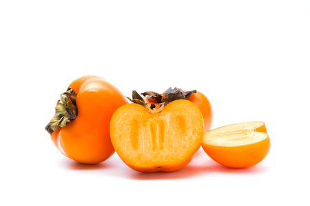 Delicious fresh persimmon fruit isolated on white background.