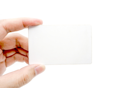 Hand holding an empty white card isolated on white background.