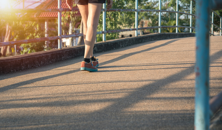 A woman running at the morning for jogging, exercising and healthy lifestyle concept. 版權商用圖片
