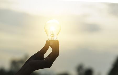 Innovation or creative concept of hand hold a light bulb and copy space for insert text. Stock Photo
