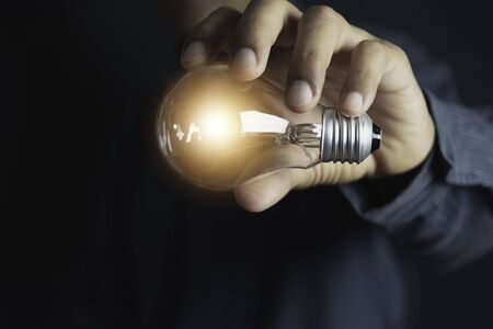 Innovation or creative concept of hand hold a light bulb and copy space for insert text.