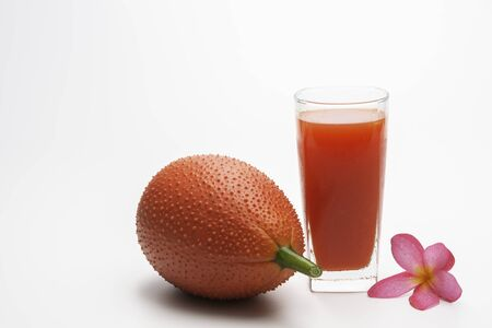 Baby Jackfruit, Gac fruit with baby jackfruit juice isolated on white background. Drink and healthy concept.