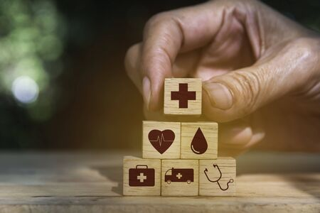 Hand holding cube dice health and medical symbols with copy space.  Healthy and medical concept.