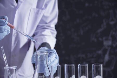 Researcher with glass laboratory chemical test tubes with liquid for analytical , medical, pharmaceutical and scientific research concept. Stok Fotoğraf