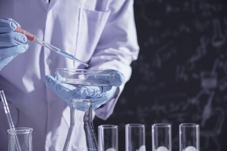 Researcher with glass laboratory chemical test tubes with liquid for analytical , medical, pharmaceutical and scientific research concept. 版權商用圖片