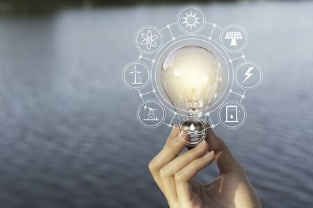 Innovation and energy concept of hand hold a light bulb and copy space for insert text. 版權商用圖片