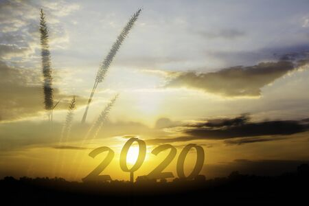 2020 Happy new year numbers on sunset sky background Stok Fotoğraf