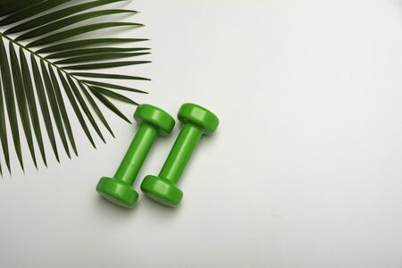 Concept preparing to fitness sports equipment with dumbbell on white background.
