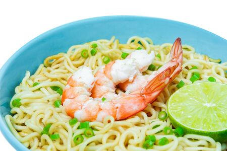 Bowl of instant noodles and shrimps isolated on white background. Food concept. 스톡 콘텐츠