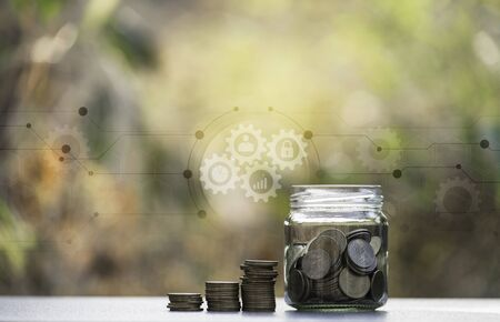 Saving money concept with money coin stack. financial and accounting concept. 스톡 콘텐츠