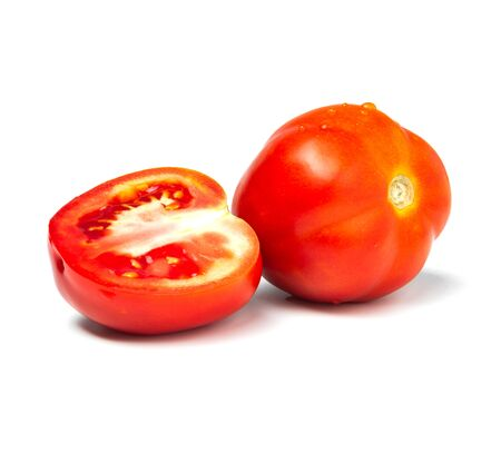 Fresh tomatoes and tomato slice isolated on white background. Close up of tomatoes.
