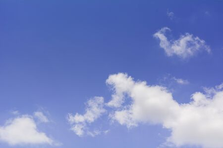 Blue sky with cloud and copy space. Clear weather background.