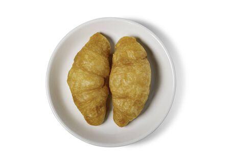 Fresh croissant on plate     on a white background. 版權商用圖片 - 148797307