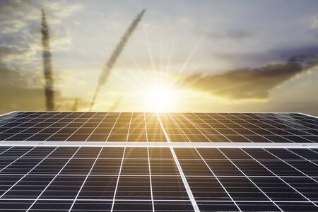 Solar panels or Solar cell in with orange sky and sunset or sunrise. Alternative electricity source and energy concept