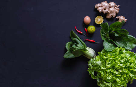 Top view of vegetables and on black background with copy space for insert text. Healthy food concept.