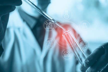 Medicine doctor with syringe in hand. Healthcare and medical concept. Stock fotó