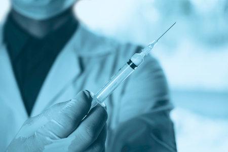 Medicine doctor with syringe in hand. Healthcare and medical concept. Reklamní fotografie - 162914367