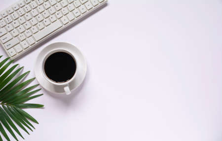 Top view of coffee with other supplies and keyboard on white background and copy space for insert text. 版權商用圖片