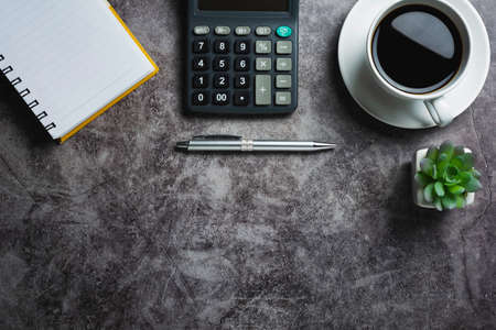 Concrete table with coffee with office accessories.Top view of Coffee cup on concrete background with copy space. 免版税图像