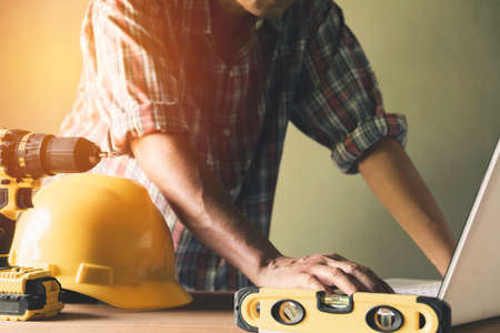 Architect engineer working concept and construction tools or safety equipment on table. 免版税图像