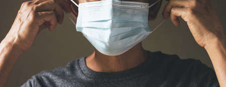 A man waring the medical masks for protecting virus and dust. Healthy concept.