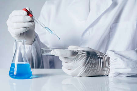 Researcher with glass laboratory chemical test tubes with liquid for analytical , medical, pharmaceutical and scientific research concept. 免版税图像
