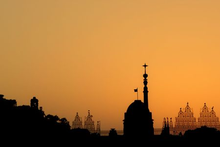 The silhouette of Rashtrapati Bhavan - the President House of India and the symbol of the success of the largest democracy of the world - on the background of orange color.