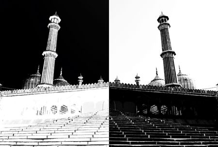 opposites: This is a tower of big mosque of old Delhi, which is used in this image as an allegory of white and black chess rooks fighting, representing also additional meaning like fight of good and bad and all possible opposites. Purely conceptual image. Stock Photo