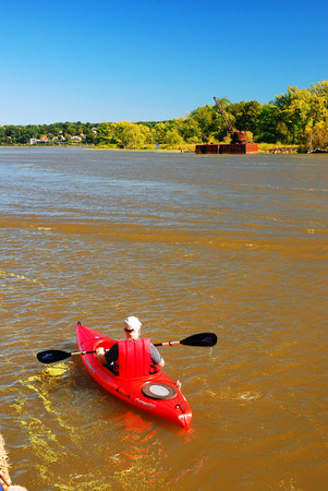 kingston: Lone Kayaker on Rondout Creek, a Tributary to the Hudson River, Kingston, New York Editorial
