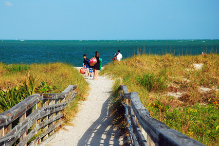 key biscayne: A Family Arrives on a Sunny Summer Day in Key Biscayne, Florida Stock Photo