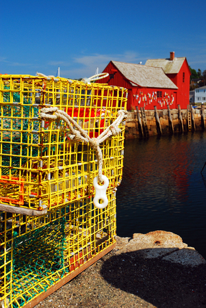 to dominate: Lobster Traps Dominate the Working Port of Rockport, MA Stock Photo