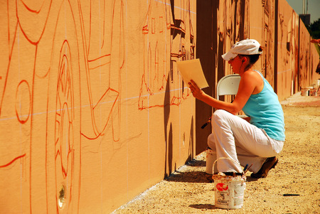 Painting a mural along the interstate, Denton Texas