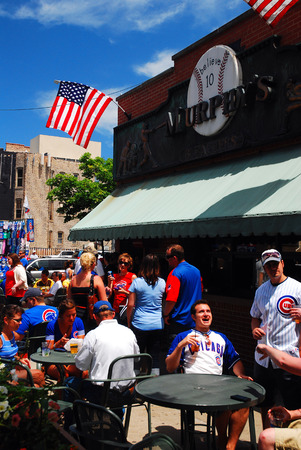 Fans Celebrate a Cubs Win at Murphys, One of Several Pubs Within Walking Distance of Baseball Stadium Wriggley Field